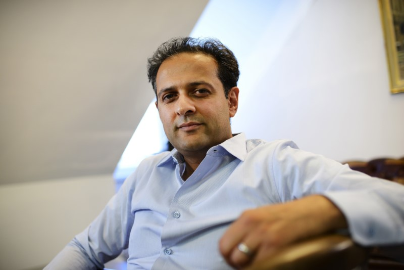 Rishi Khosla, co-founder and Chief Executive Officer of OakNorth Bank poses during an interview in London
