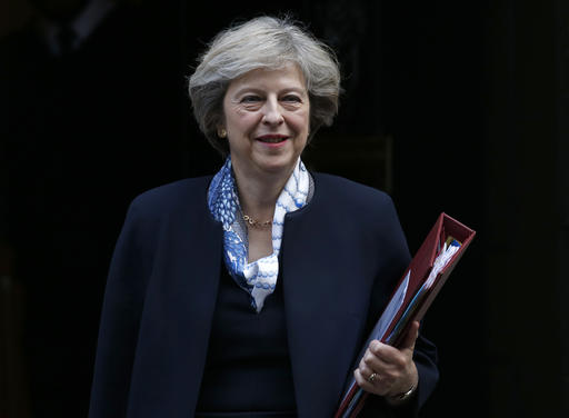 (AP Photo/Alastair Grant). Britain's Prime Minister Theresa May leaves 10 Downing Street for the House of Commons for her weekly Prime Minister's Questions, in London, Wednesday, Oct. 12, 2016.
