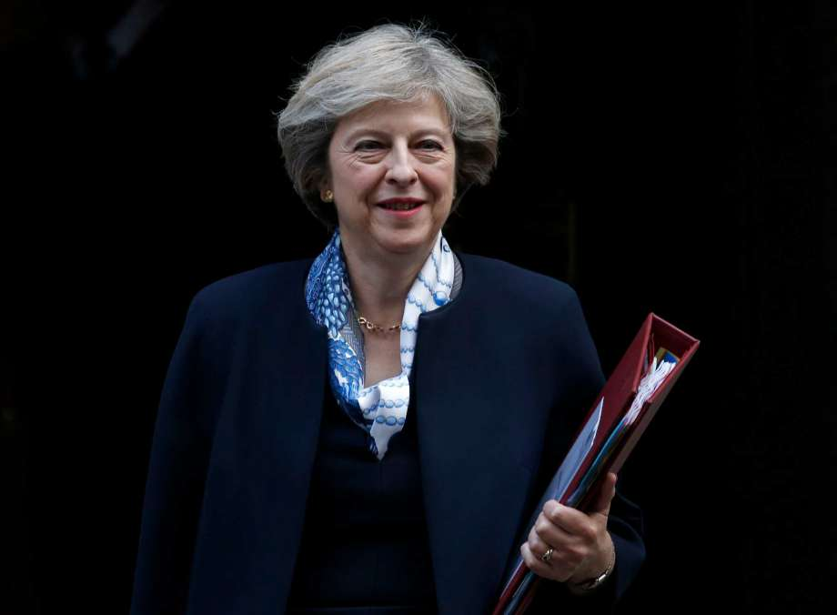 Britain's Prime Minister Theresa May leaves 10 Downing Street for the House of Commons for her weekly Prime Minister's Questions, in London, Wednesday, Oct. 12, 2016. Photo: Alastair Grant, AP / Copyright 2016 The Associated Press. All rights reserved.